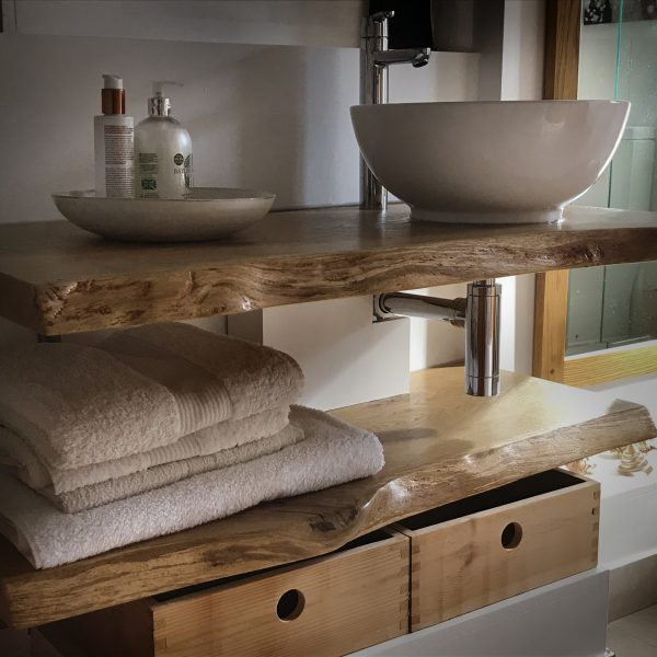 Live edge resin filled bespoke solid oak bathroom sink top in rustic cottage style bathroom
