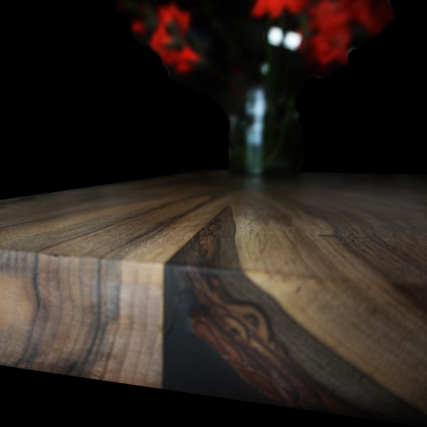 Beautiful bark presrevation and resin infused edging of bespoke wild walnut worktop surface