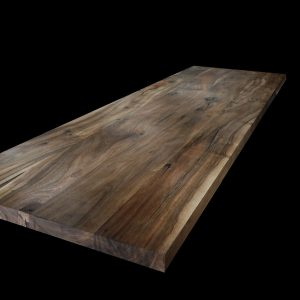 Beautiful straight edged modern contemporary wild walnut worktop showing unique grain and deep rich autumnal tones