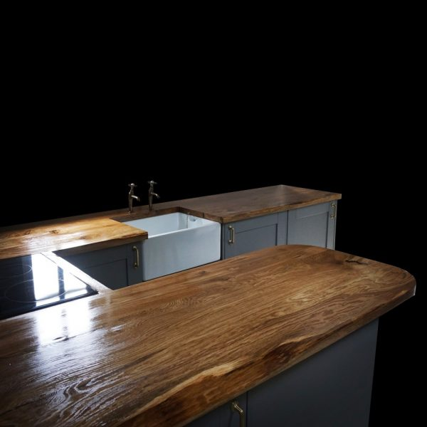 Beautiful rustic styled oak kitchen island with resin filled knots, cracks and voids with matching kitchen worktops