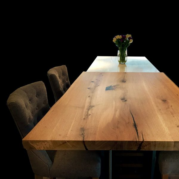 Beautiful bespoke oak kitchen island worktop / high table in modern contemporary kitchen showing unique luxury grain