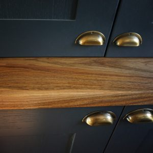 Modern contemporary cabinet with wild walnut cabinet top with straight, square edging