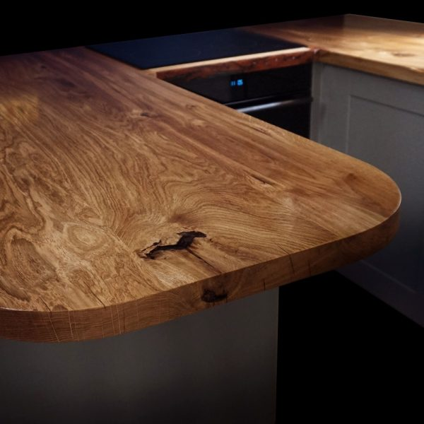 Stunning unique curved edge kitchen islands showing beautiful earthy grains and resin filled knots