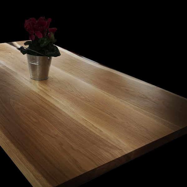Beautiful rustic oak table top showing earthy grain detail and resin filled edges