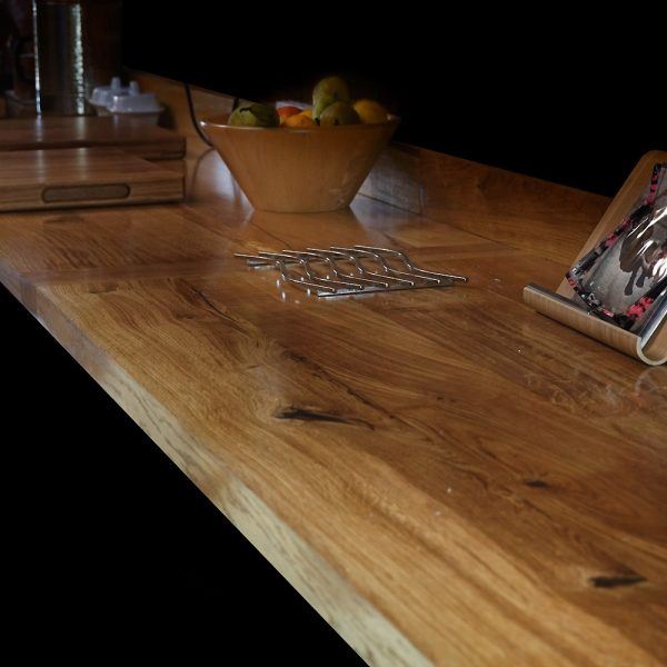 Beautiful rustic oak worktops in contemporary kitchen with resin infused natural features and modern kitchen decor
