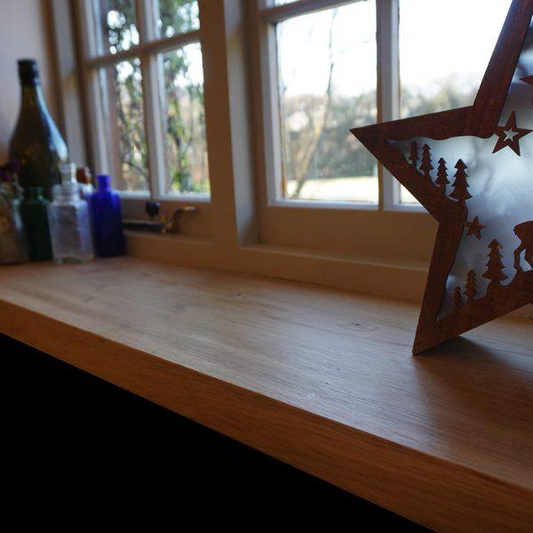 Beautiful bespoke oak window sill with modern contemporary decor