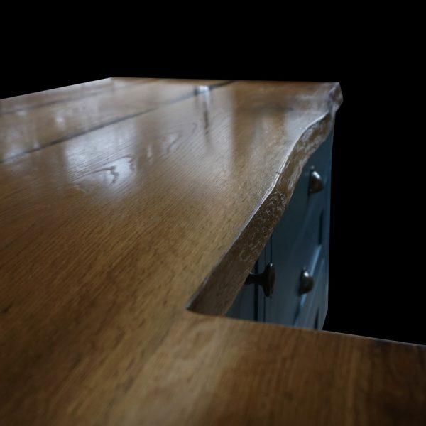 Beautiful waney edged oak worktops with modern contemporary navy cupboard units