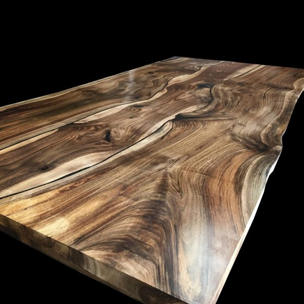 Beautiful earthy grain detail of wild walnut kitchen island top infused with resin