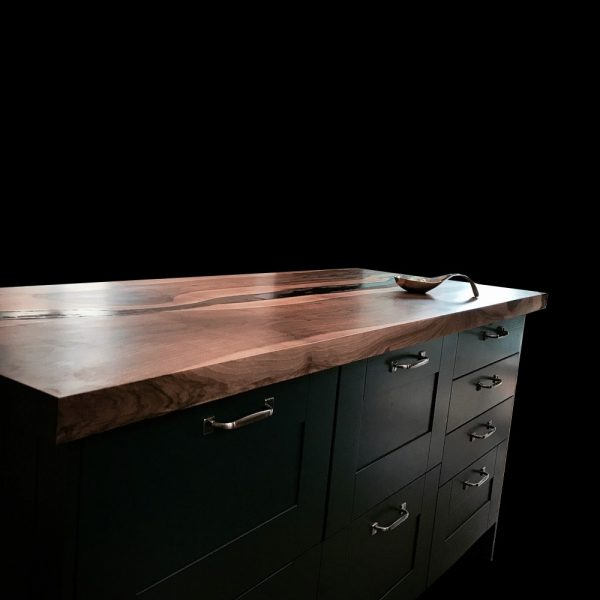 Bespoke resin infused wild walnut kitchen worktop with dark drawers in modern contemporary kitchen