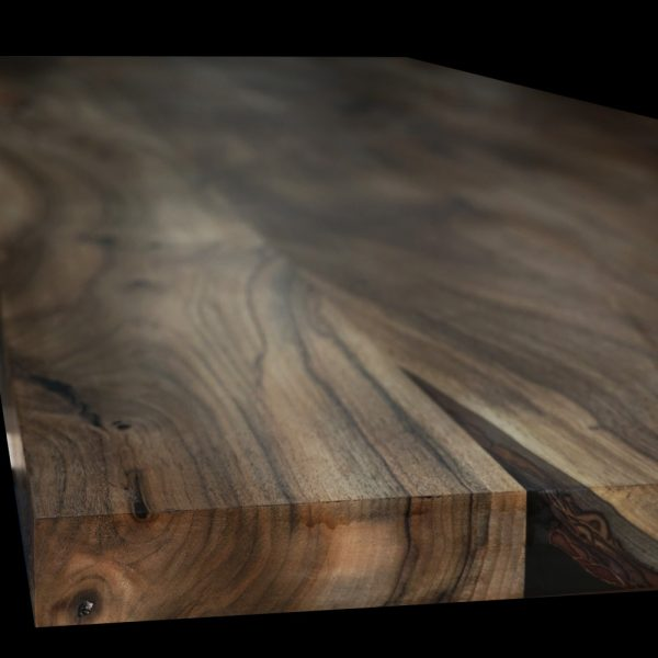 Beautiful raw distinctive grain detail on wild walnut worktop showing deep rich autumnal colourings and unique resin & bark preservation