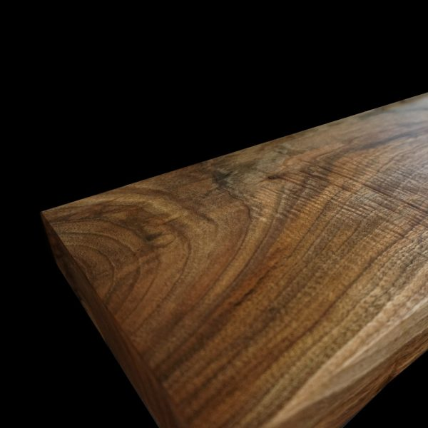 Beautiful bespoke wild walnut worktop surface showing unique earthy distinctive grains and autumnal tones