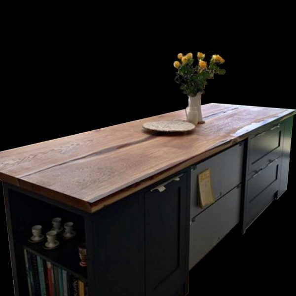 Beautiful rustic styled oak kitchen island with resin infused river effect through centre on navy kitchen countertop