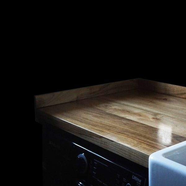 Beautiful bespoke wild walnut worktop with modern contemporary straight edging and matching upstands in modern kitchen