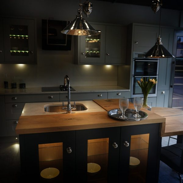 Bespoke modern and contemporary kitchen with unique rustic oak kitchen worktop showing unique earthy resin infused imperfections