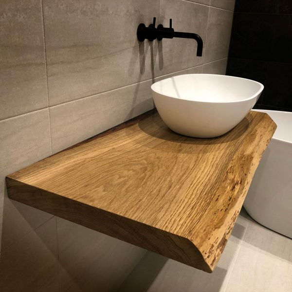 Beautiful bespoke earthy oak sink top in modern contemporary bathroom