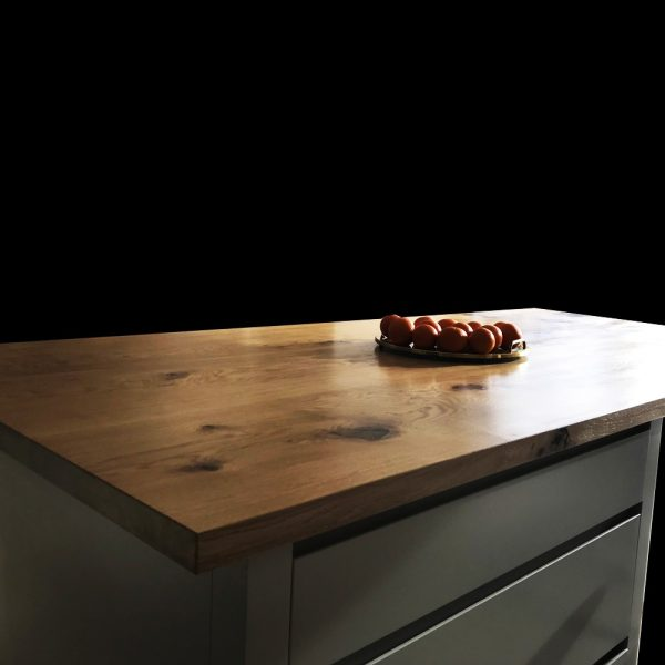 Straight/ square edged modern contemporary oak kitchen island top showing natural resin infused grains and knots