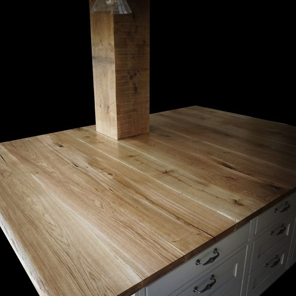 Beautiful rustic natural details of large oak kitchen islands shwoing knots, cracks and striations