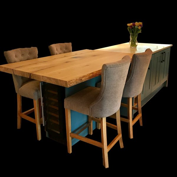 Bespoke oak kitchen island top in modern contemporary kitchen doubled as a breakfast bar, worktop and high table