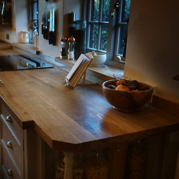 Rural rustic styled kitchen with beautiful oak worktops delicately infused with epoxy resin