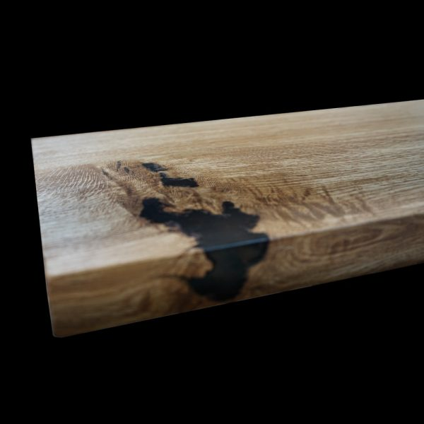 Beautiful resin infused knots, cracks and striations of bespoke oak bench top