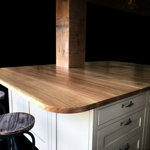 Beautiful bespoke straight edged oak kitchen island with unique curved edges in modern contemporary kitchen