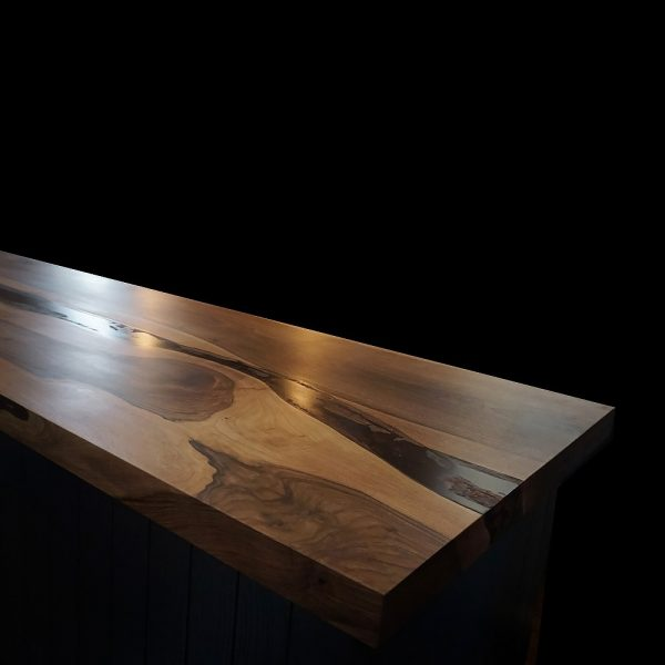 Unique rich warming earthy wild walnut kitchen island top showing unique grains and resin infused natural imperfections