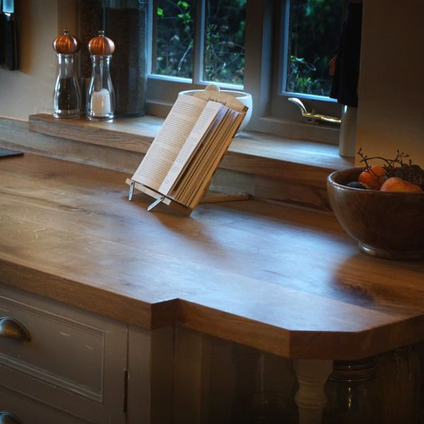 Custom sized earthy english oak kitchen worktop in radiant warming rustic styled kitchen