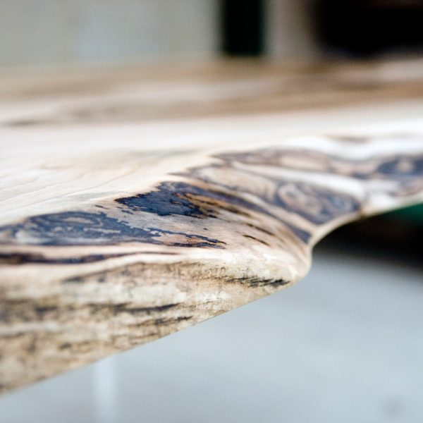 Stunning up close detail of waney edged wild walnut desk top