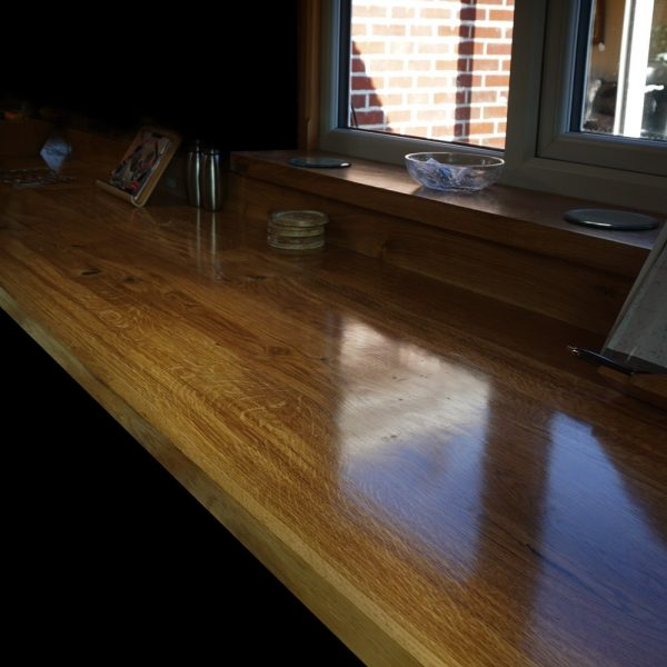 Unique polished rustic oak worktop with modern contemporary straight edging, matching upstands and window sills