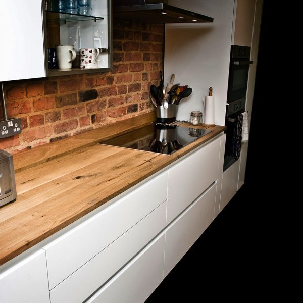 Beautiful bespoke solid wooden straight edged oak worktops in modern contemporary kitchen