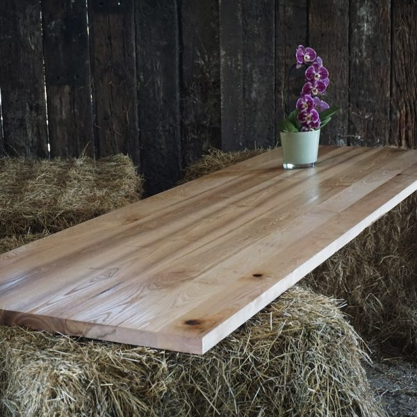 Beautiful bespoke straight edged oak table with resin infused knots in rustic barn