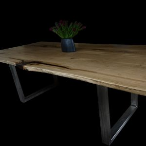 Beautiful rustic oak table top with steel trapezium legs are glassy resin infused detail