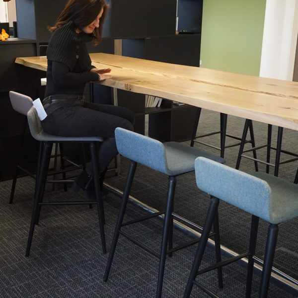 Beautiful waney edged oak high table in modern contemporary office space