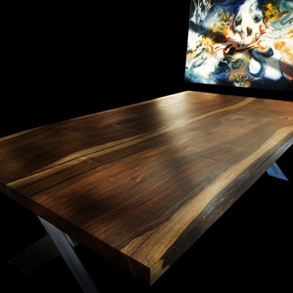 Beautiful unique wild walnut table top showing beautiful earthy grain detail and X-shaped steel legs
