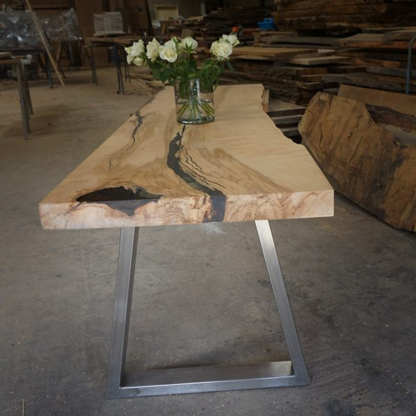Bespoke earthy sycamore table top with steel trapezium shaped legs infused with resin