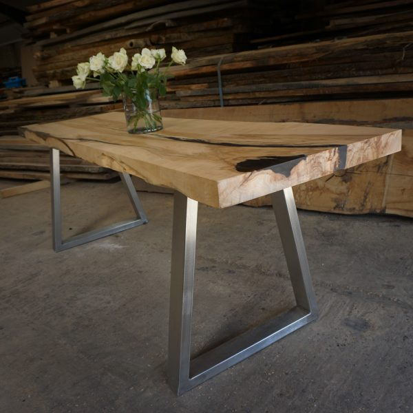 Beautiful earthy sycamore table top infused with epoxy resin with steel trapezium legs
