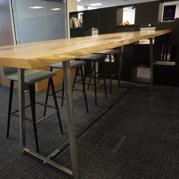 Bespoke rustic oak waney edged high table in modern contemporary office space