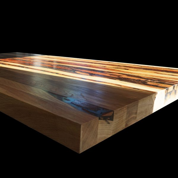 Beautiful earthy English reclaimed hardwood bar with resin infused cracks, knots and striations
