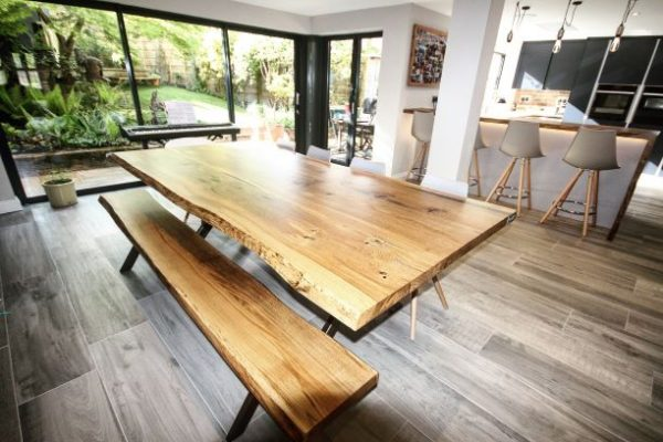 contemporary wood dining table by Earthy Timber
