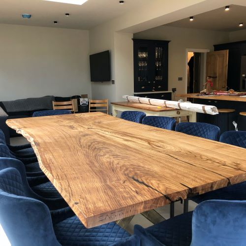 wavy edge oak slab dining table by Earthy Timber