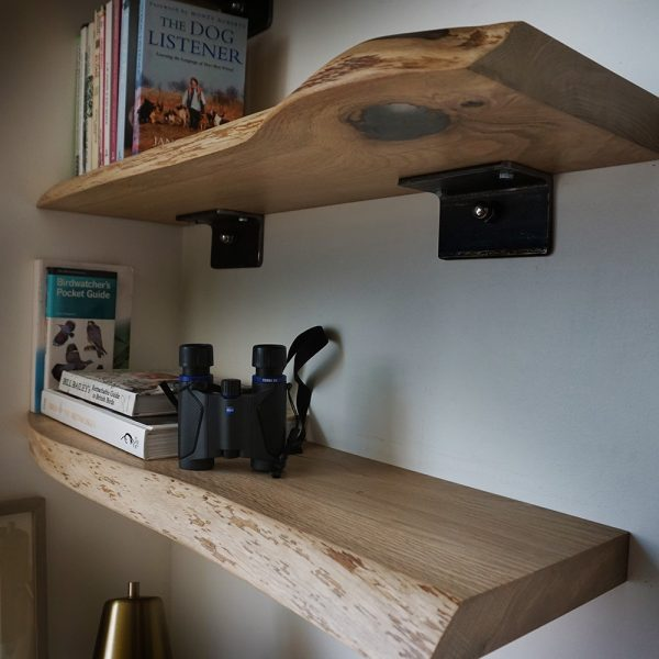 Beautiful bespoke live edged oak shelving with resin infilled detail in modern office