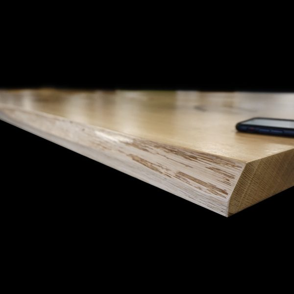 Beautiful bespoke part live part straight edged oak table top showing grainy detail