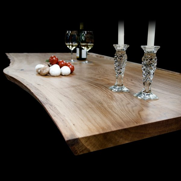 Beautiful bespoke wide solid wooden live edged table with classy dining table ornaments on top