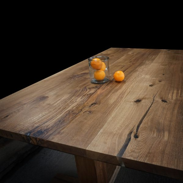 Gorgeous earthy grain detail showing resin infused natural imperfections on rustic oak desk top