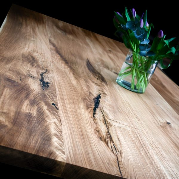 Beautiful rustic oak desk top showing unique earthy resin fused knots, cracks and striations and unique grains