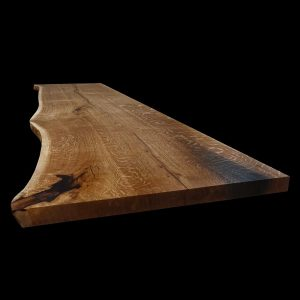 Beautiful live edging on resin infilled earthy scarred oak showing beautiful organic detail