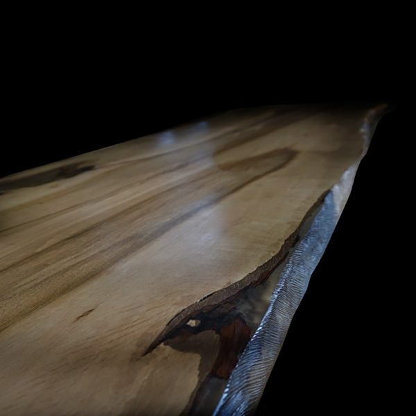 Beautiful resin infused edging detail of our earthy sycamore desk tops showing live/ waney edging