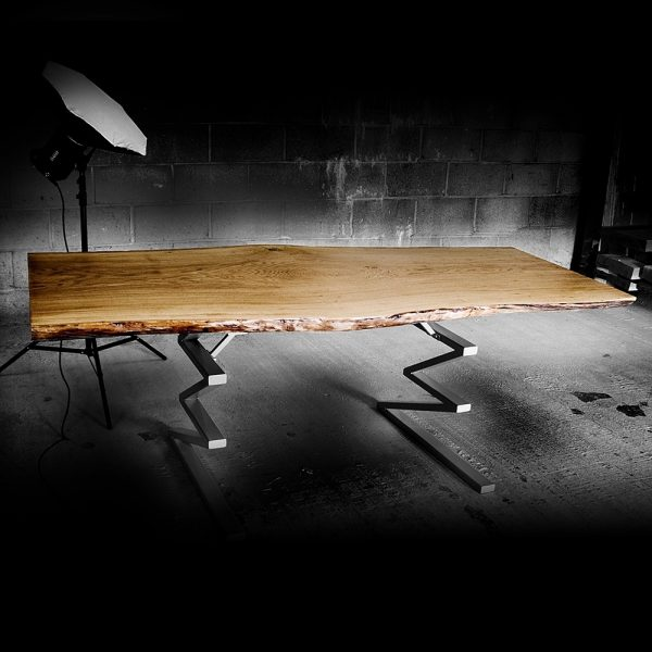 Bespoke rustic oak slab desk top with unique live/ waney edging and custom zig-zag shaped steel legs in workshop