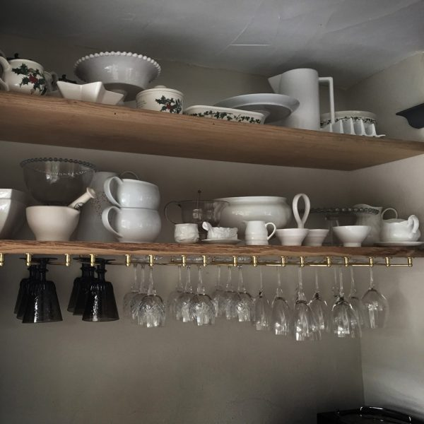 Beautiful bespoke solid wooden shelving units with unique live edging with wine rack attached and beautiful modern styled crockery