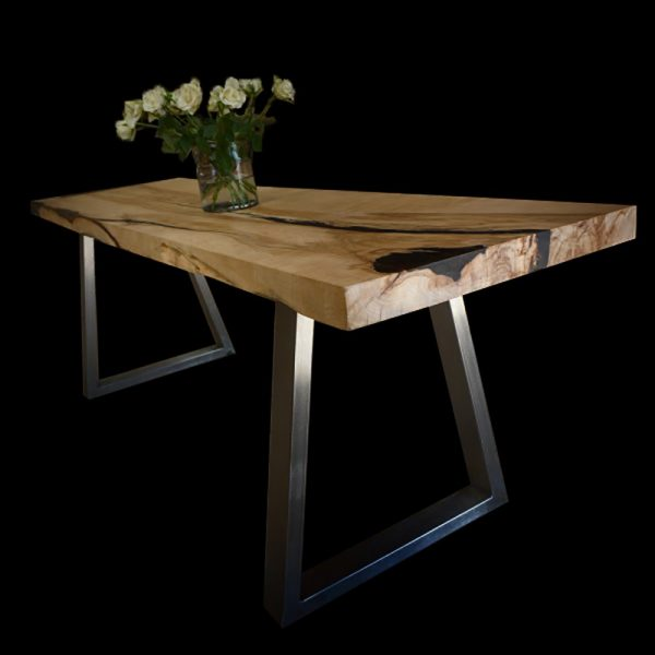 Beautiful bespoke sycamore desk top with trapezium shaped steel legs showing unique resin infused cracks, knots and striations
